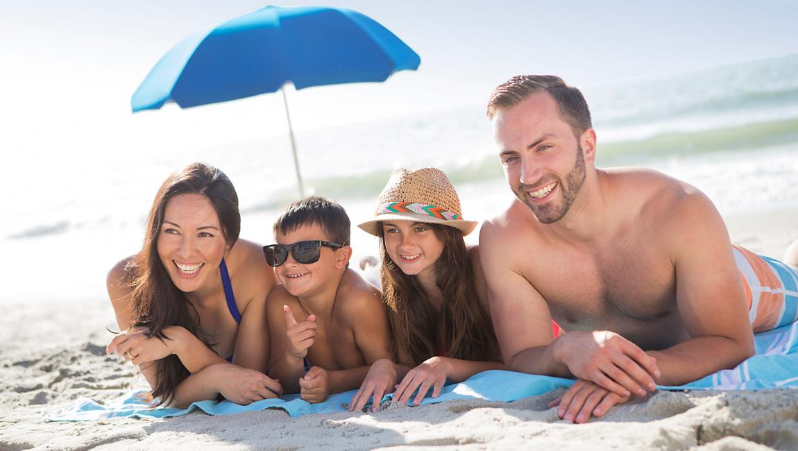 Family under an umbrella in Myrtle Beach